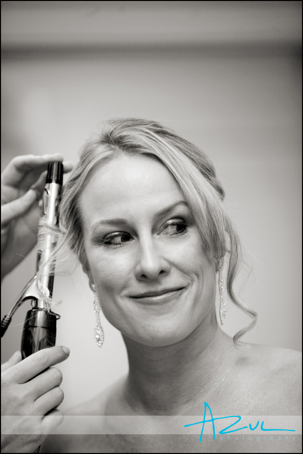 Jenna smiles for her photograph while getting ready before her Wilson wedding