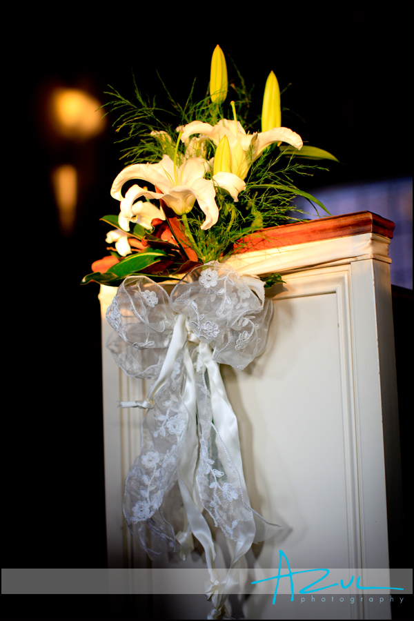 The First Presbyterian Church gets ready with flowers on the pews for a wedding in Wilson