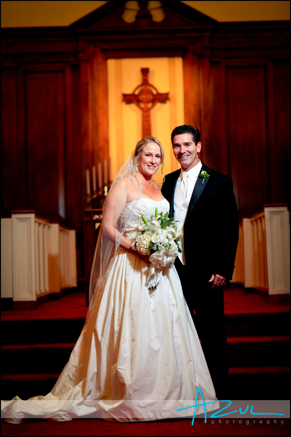 Jenna smiles for the photographer with her husband while at her Wilson wedding