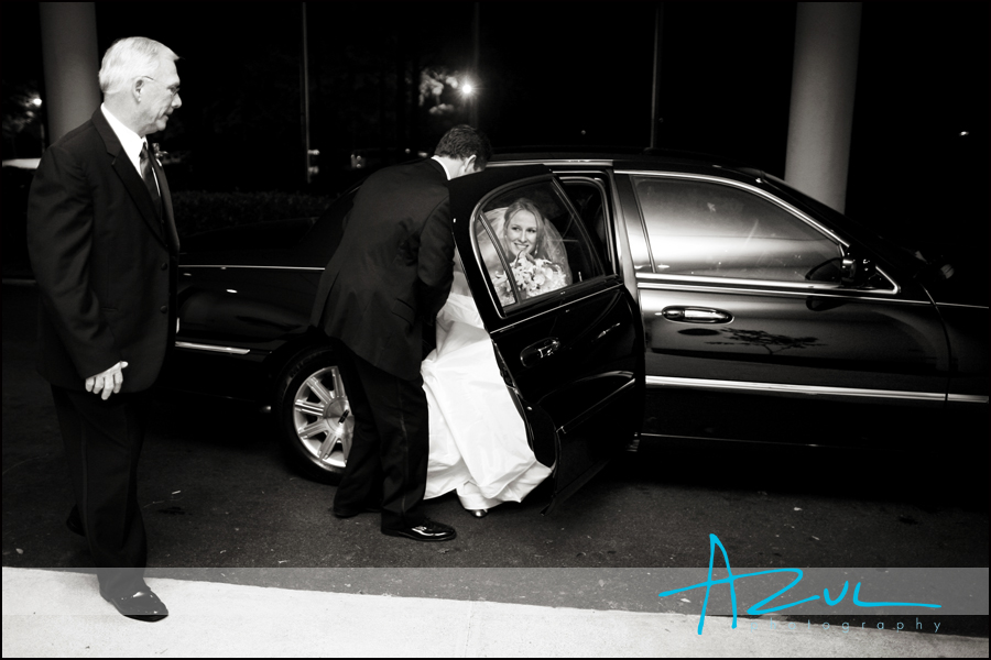 The groom assists his bride as they arrive to the Wilson Country Club for the reception.